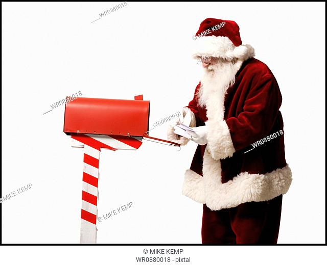 santa getting mail out of his mailbox