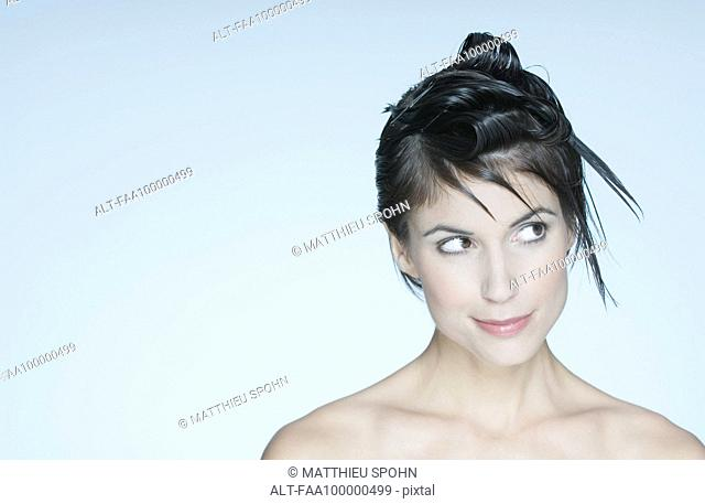 Woman with spiky hairstyle, looking away, portrait