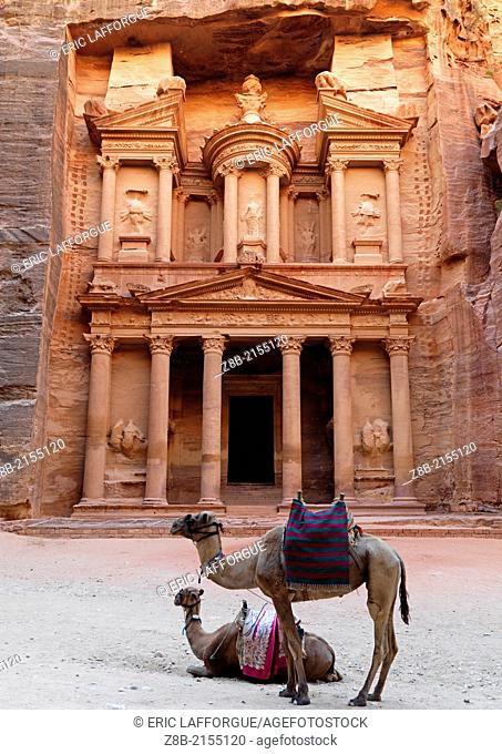 the Treasury (el Khazneh) is carved out from the sandstone cliff wall, it was probably a temple tomb, Petra is in a valley and was founded by the Nabatean...