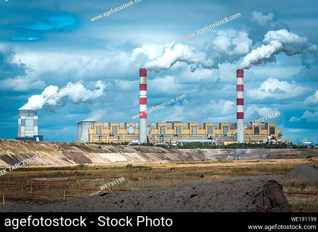 Coal ower plant smokestacks emitting smoke by chimneys