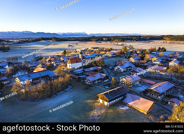 Village Lochen with church St. Magdalena in the morning light, near Dietramszell, Alpine chain, drone recording, foothills of the Alps, Upper Bavaria, Bavaria