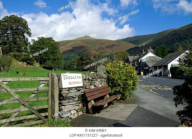 England, Cumbria, Grasmere. Sign on wall showing direction of Keswick and Easedale Tarn