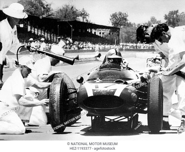 Jack Brabham's Cooper in the pits, Indianapolis 500, Indiana, USA, 1961. Mechanics attend to Brabham's Cooper-Climax during a pit stop