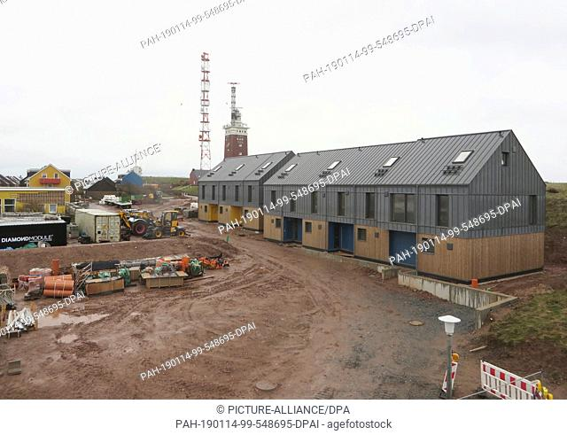 10 January 2019, Schleswig-Holstein, Helgoland: The first houses made of prefabricated modules stand not far from the Helgoland lighthouse on the Oberland
