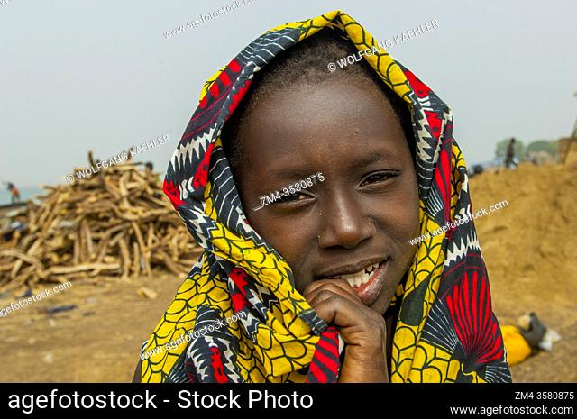 Portrait of a local girl on the bank of the Niger River in Segou, a city in the center of Mali, West Africa
