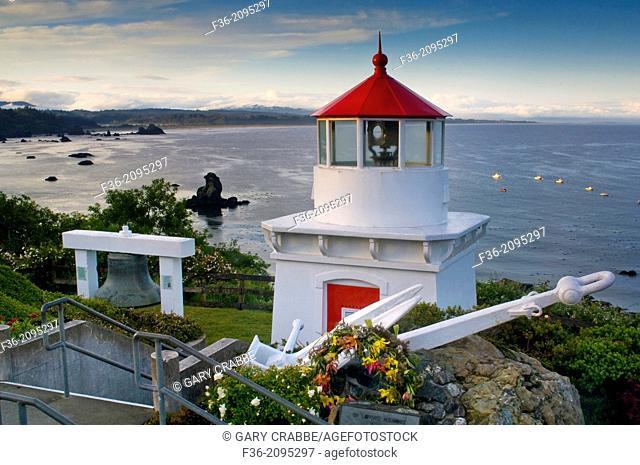 Trinidad Memorial Lighhouse overlooking fishing boats anchored in the ocean, Trinidad, California