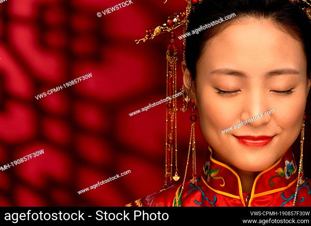 Beautiful Chinese bride with your eyes closed