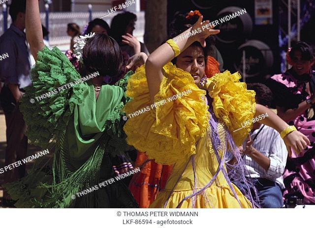 Young women in colourful frilly dresses dance Flamenco, Jerez de la Frontera, Cadiz province, Andalusia, Spain
