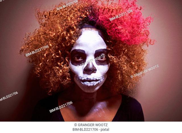 Black woman wearing skull makeup