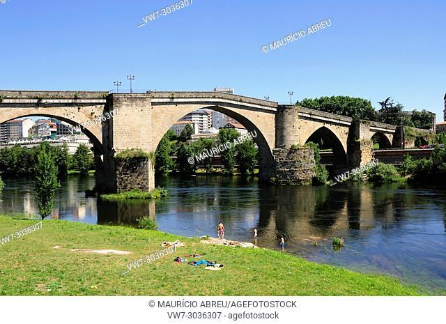 Roman bridge along the Minho river. Ourense, Galicia. Spain