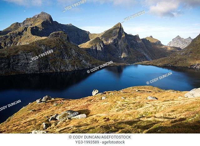 Hermannsdalstinden mountain peak left in Autumn, Moskenesøya, Lofoten Islands, Norway