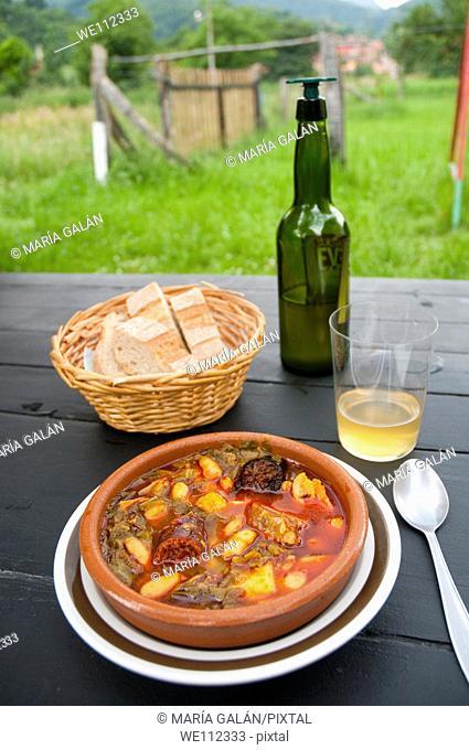 Pote asturiano serving and cider. Cabrales, Asturias province, Spain