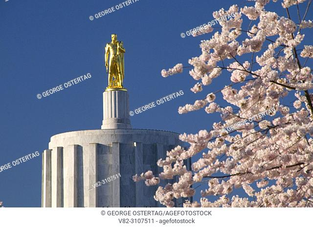 Oregon Pioneer statue (Capitol Dome) with cherry blossoms, State Capitol State Park, Salem, Oregon