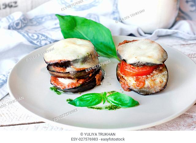 Parmigiana di melanzane: baked eggplant - italy, sicily cousine. On the wooden table