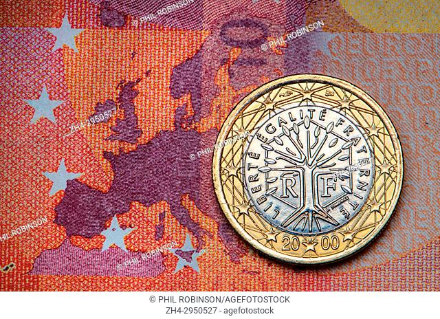 French 1 Euro coin on a 10 Euro note