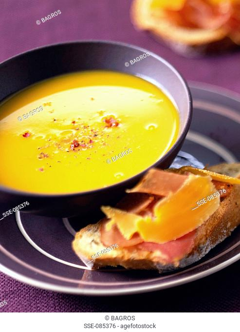 creamed pumpkin soup with mountain ham on bread