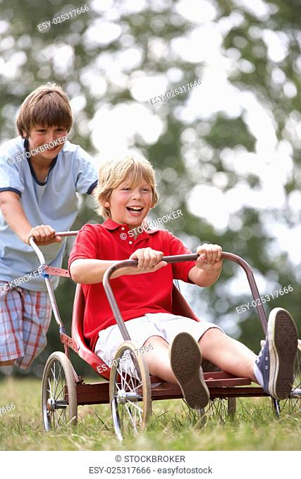 Young boys playing with go-kart