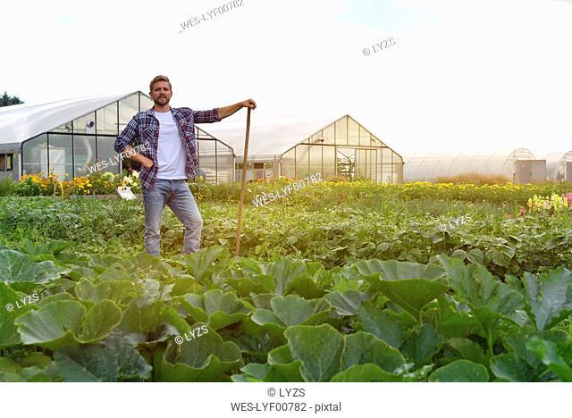 Farmer standing in vegetable field