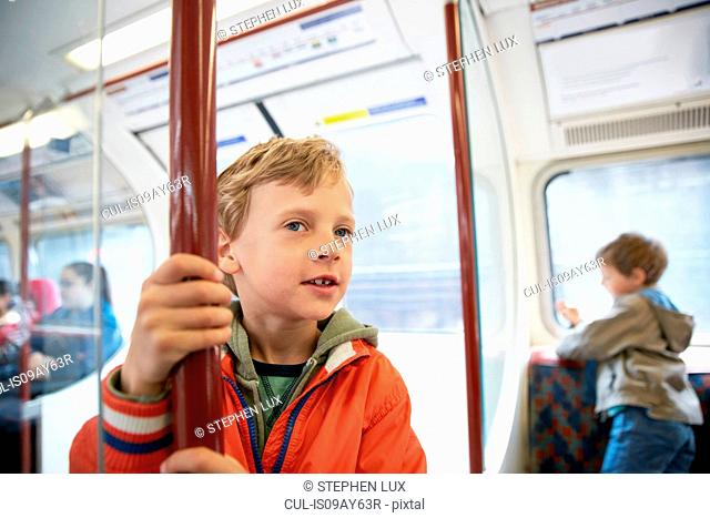 Boys in tube train carriage