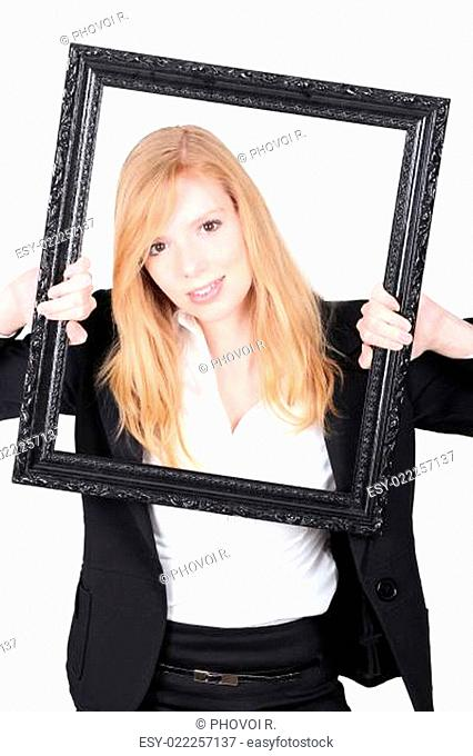 Young blonde behind the black box frame