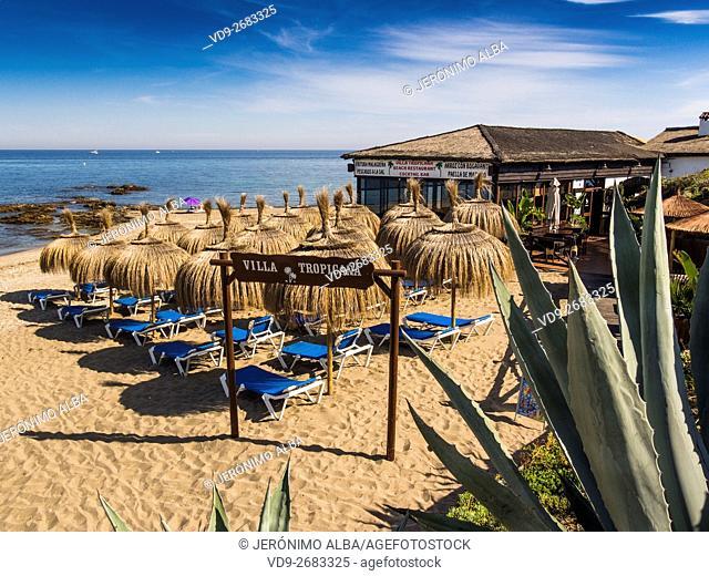 Villa Tropicana Chiringuito, beach restaurant and umbrellas. Mijas Costa, Malaga province, Costa del Sol, Andalusia, Spain Europe