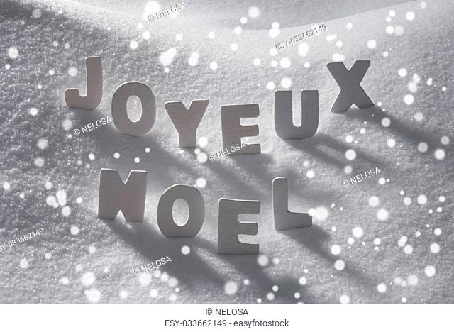 White Wooden Letters Building French Text Joyeux Noel Means Merry Christmas. Snow And Snowy Scenery With Snowfalkes. Christmas Atmosphere