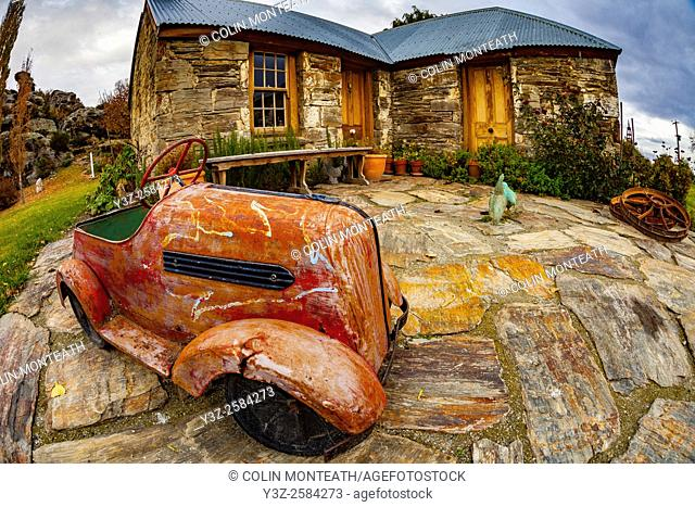 Antique toy car outside farm house, Ophir, Otago, New Zealand
