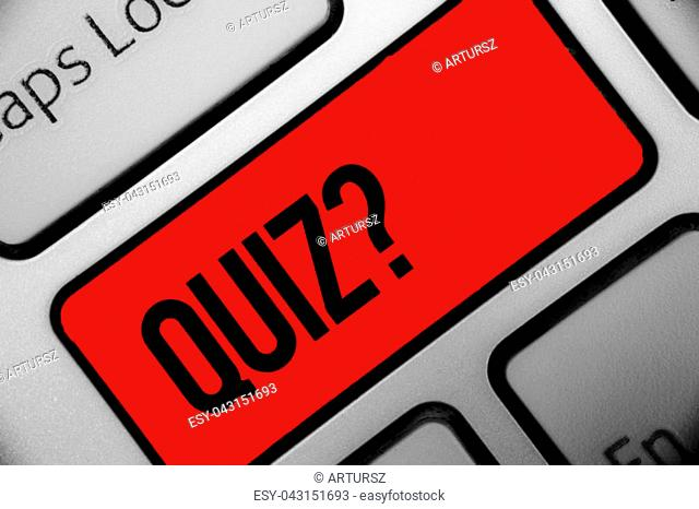Handwriting text writing Quiz Question. Concept meaning Short Tests Evaluation Examination to quantify your knowledge Keyboard grey key silver laptop computer...