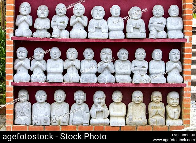 Close up view of a bunch of tiny Buddha statues