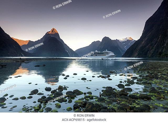 A cruise ship on Milford Sound, a fiord on the West Coast of New Zealand's South Island in Fiordland National Park