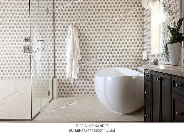 Contemporary bathroom with cropped bath and glass shower at home; Irvine; California; USA