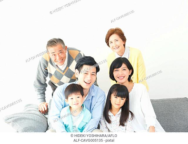 Three-generation Japanese family on the sofa in the living room