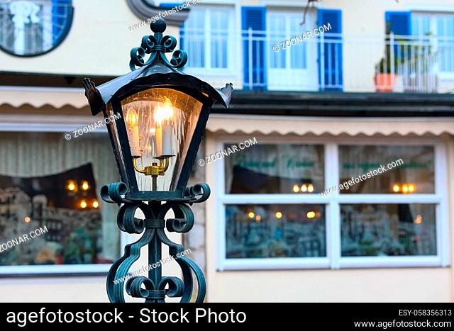 Christmas or New Year background with street lamp light, and house