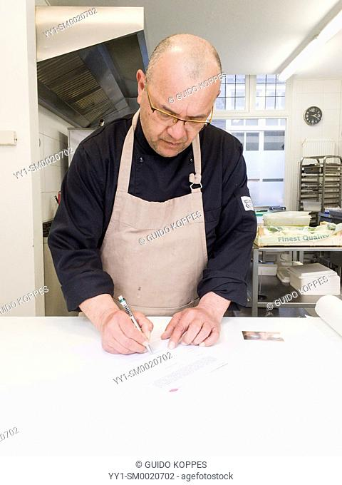 Tilburg, Netherlands. Professional male chef signing a release just after being photographed