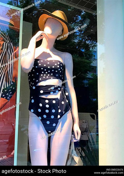 Mannequin wearing swimsuit in a shop window. Madrid, Spain