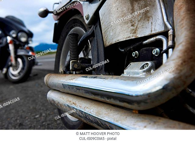Exhaust pipes of motorcycle covered in dirt
