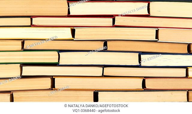 abstract texture from stacks of various hardback books, full frame, concept back to school