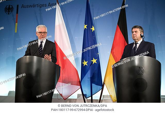 German Foreign Minister Sigmar Gabriel (R, SPD) and his Polish counterpart, Jacek Czaputowicz, giving statements during a joint press conference after their...