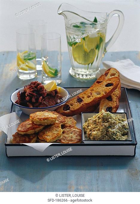 Aubergine dip, chick-pea cakes, octopus salad, olive bread