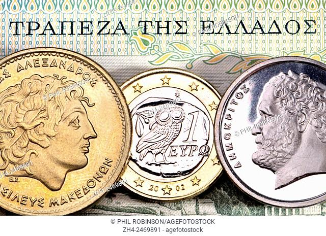 "Greek currency - drachmas and Euro. Alexander the Great (100 drachmas) and Demokritus (10 drachmas) and 1 Euro coin. """"Bank of Greece"""""