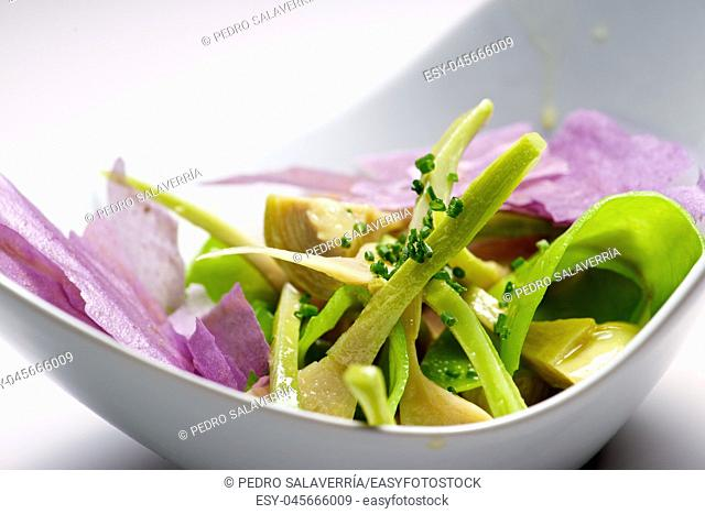 Artichoke salad and blue potato with vegetables