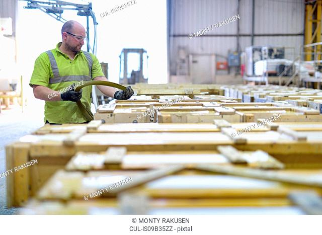 Worker moulding stone in architectural stone factory