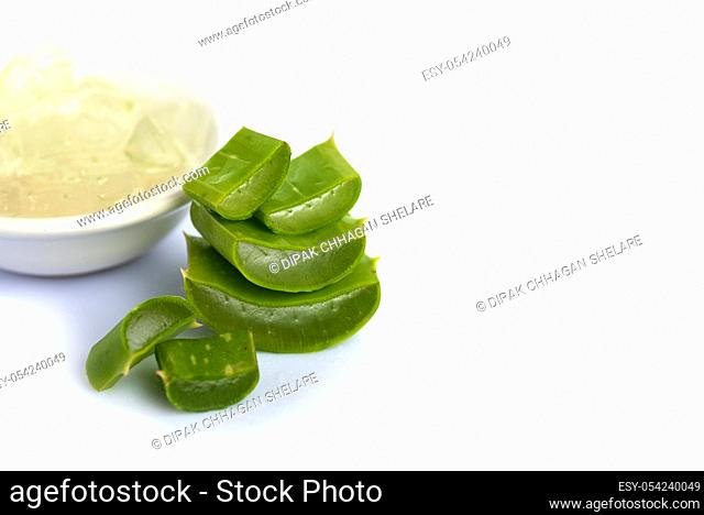 Slices of Aloe Vera leaves and Aloe Vera gel on a white background. Aloe Vera is a very useful herbal medicine for skincare and hair care