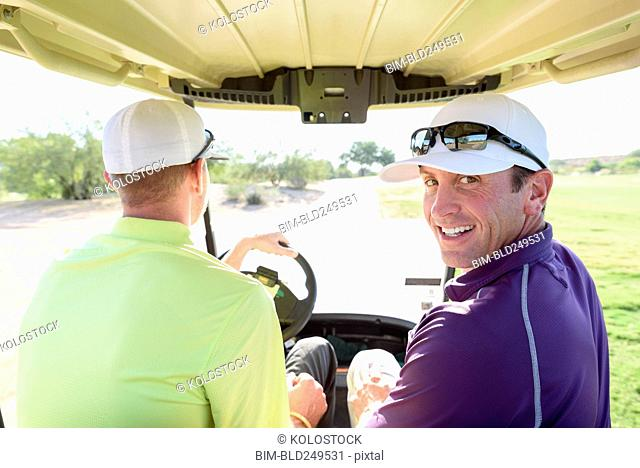 Friends driving on golf course
