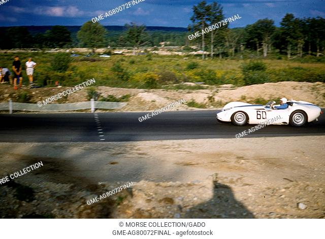Action view of Mr. Walt Hansgen racing at speed in the Lister-Jaguar prototype Knobbly No. 60 during the Sports Car Club of America's SCCA National Races in...
