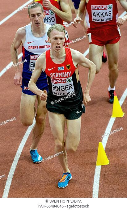 Richard Ringer (R) of Germany and Lee Emaunel of Great Britain in action during the men's 3000m competition at the IAAF European Athletics Indoor Championships...