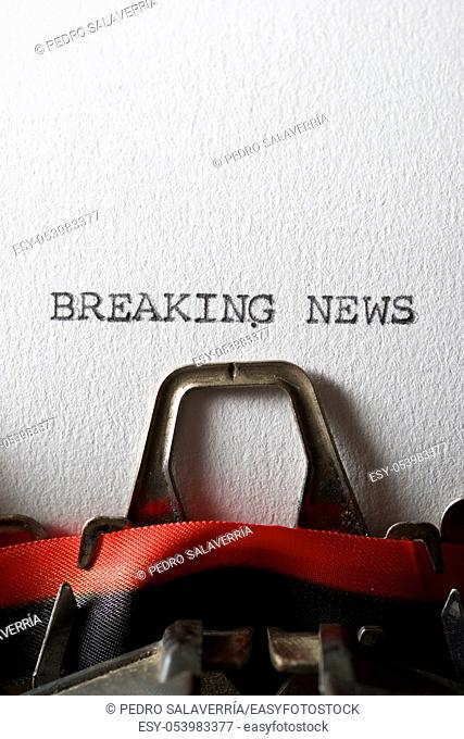 The sentence, Breaking News, written with a typewriter