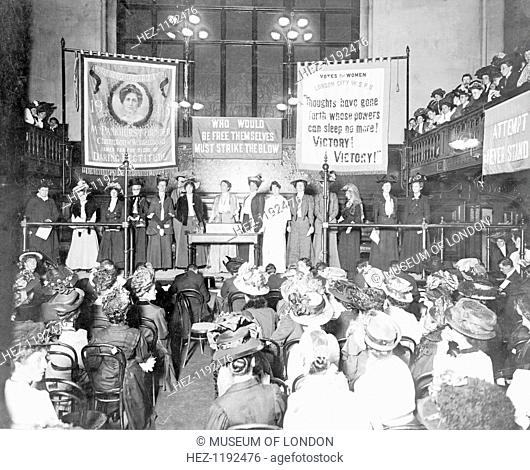 A meeting at Caxton Hall prior to the 'Rush the House of Commons' demonstration, October 1908. Senior WSPU figures address the meeting