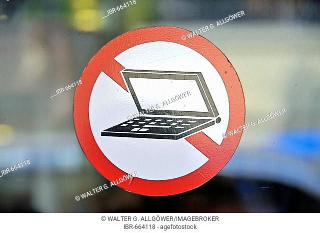 Window sticker forbidding laptops at the entrance to a restaurant in Bangkok, Thailand, Southeast Asia, Asia