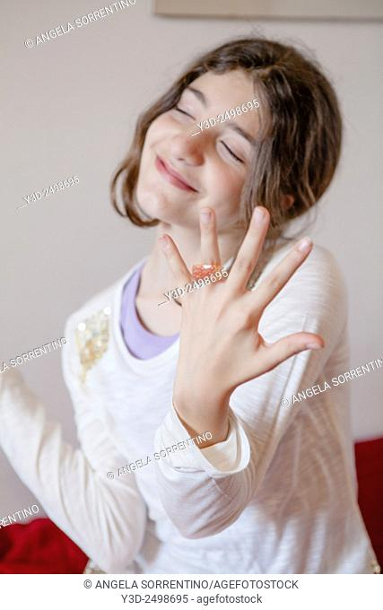 Teenage girl wearing lots of jewelry, Indoors